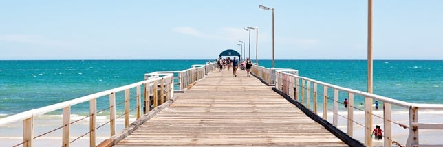 People walking on Henley Beach Jetty