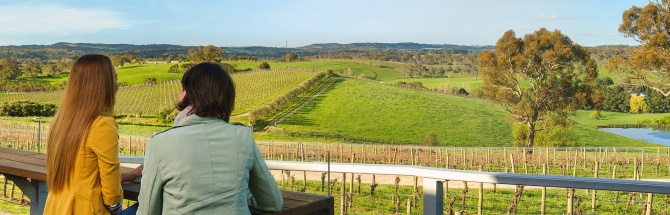 Two people enjoying the view at a winery in the Barossa Valley