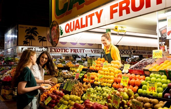 Two students shopping for fruit at Adelaide Central Markets