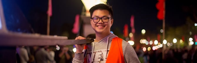Male student volunteering at the OzAsia Festival in Adelaide