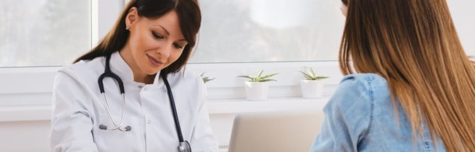 Female student in doctor consultation