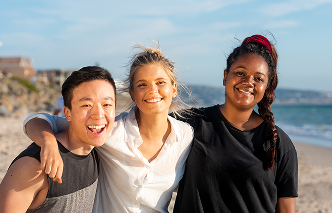 International students smiling and having fun at the beach in South Australia